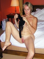 Sexy mom flashes panties and shaved pussy