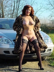 Excited granny naked in a luxurious fur..