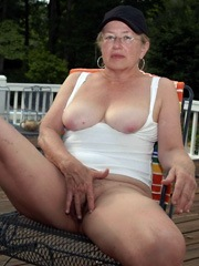 Naked old woman fondles her clit