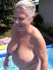 Shapely granny absolutely naked at the..