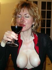 Drunk mother bare-chested drinking wine..
