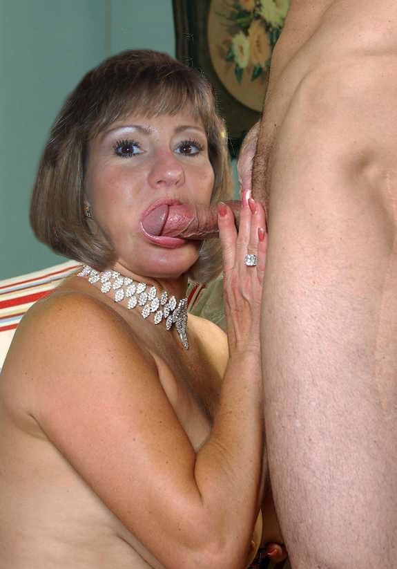Milf sucking his dick hard after he cums in her mouth