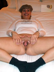Naked Mom caressing her hairy vagina in..